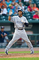 Devon Travis (6) of the West Michigan Whitecaps crosses home plate after hitting a home run against the Great Lakes Loons at the Dow Diamond on June 11, 2013 in Midland, Michigan.  The Loons defeated the Whitecaps 13-6.  (Brian Westerholt/Four Seam Images)