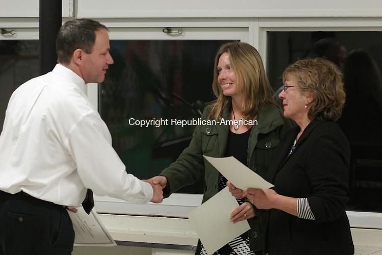 BETHLEHEM, CT: 20 Oct. 2015: 201015CB01: BETHLEHEM -- Region 14 Board of Education Chair George Bauer, left, recognizes Bethlehem residents Tai Kern, center, and Nancy Stein for their efforts to help install a vegetable garden at Bethlehem Elementary School. Caleb Bedillion Republican-American