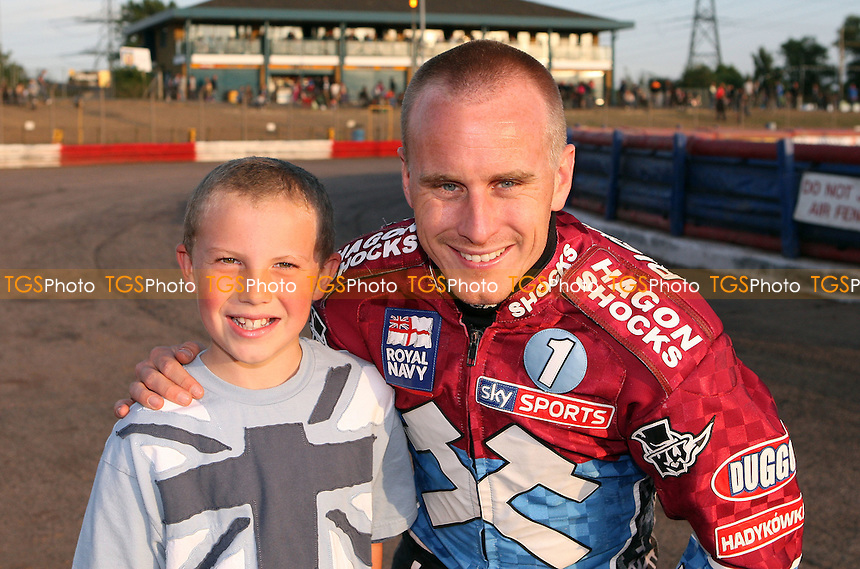 Lee Richardson with the Lakeside mascot - Lakeside Hammers vs Coventry Bees, Elite League Speedway at the Arena Essex Raceway, Purfleet - 06/08/11 - MANDATORY CREDIT: Rob Newell/TGSPHOTO - Self billing applies where appropriate - 0845 094 6026 - contact@tgsphoto.co.uk - NO UNPAID USE.