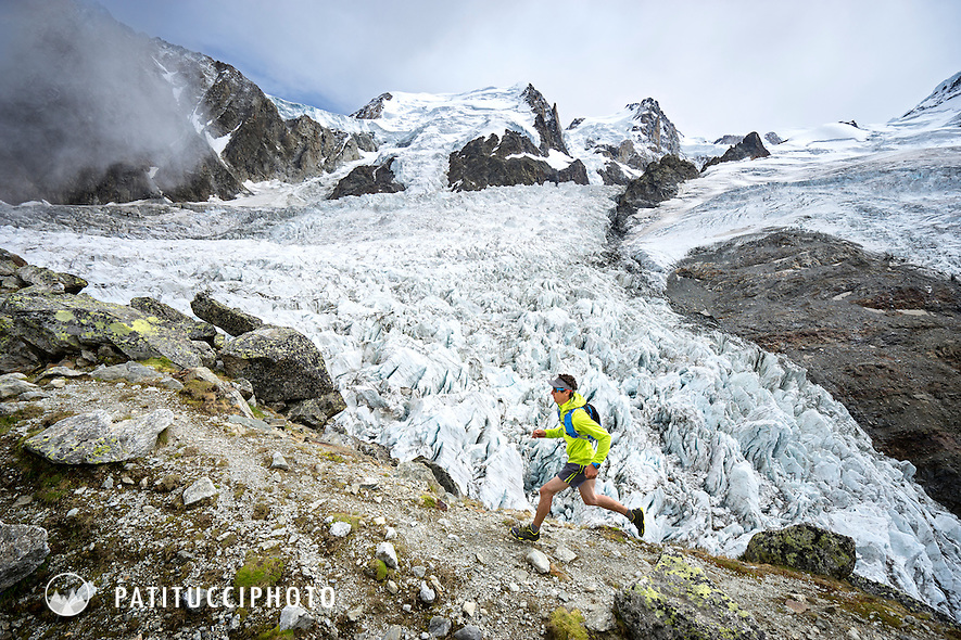 Trail running along the Bossons Glacier, beneath the Aiguille du Midi and Mont Blanc. Chamonix, France.