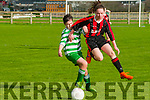 Listowel Celtic U/14 Cara Trainor & AK United's Eve O'Sullivan strife for possession in the quarter final of the Nation cup at Pat Kennedy Park, Listowel on Sunday last.