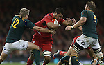 Wales number 8 Toby Faletau runs into trouble as Springbok pair Jean De Villiers and Duane Vermeulen close in.<br /> <br /> 2013 Dove Men Series<br /> Wales v South Africa<br /> Millennium Stadium<br /> 09.11.13<br /> &copy;Steve Pope-Sportingwales