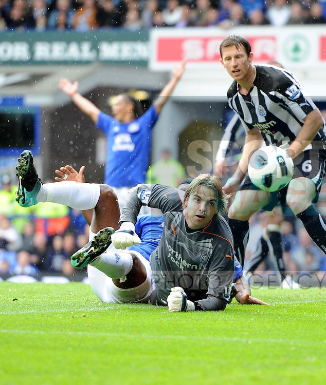 Tim Krul of Newcastle United saves at the feet of Ayegbeni Yakubu of Everton