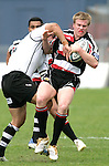 Lance Easton gets hit in a strong tackle during the Air New Zealand Cup rugby game between Counties Manukau & Hawkes Bay played at Mt Smart Stadium, 30th of September 2006. Hawkes Bay won 30 - 29.