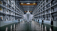 BNPS.co.uk (01202 558833)<br /> Pic: FranciscoMartinez/Oceanco/BNPS<br /> <br /> Not the set from the latest James Bond movie - These stunning photographs actually reveal 'Project Jubilee', the largest Super-yacht ever built in Holland.<br /> <br /> Oceanco have constructed the sleek 110m, 4500 ton craft inside its own covered dry dock to include on its six decks a pool with its own aquarium, a helicopter pad with concealed hanger, spacious accomodation for 30 lucky guest's and even a complete deck for use of the owner exclusively.<br /> <br /> Oceanco will deliver the 'turn-key' yacht to it's secret owner in the summer, all ready to start cruising the Med with its own bespoke tender, jetskis, china, crystal, silverware and soft furnishings.