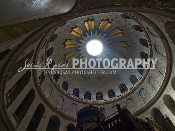 Church of the Holy Sepulchre. The top of the edicule of the church allows the light coming in right above of what it is believed is the tomb of Jesus. This is considered the holiest place in Christianity.