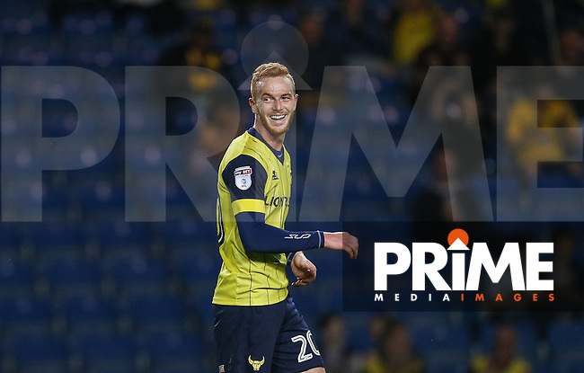 Ryan Taylor of Oxford United smiles as he scores his goal during the The Checkatrade Trophy match between Oxford United and Exeter City at the Kassam Stadium, Oxford, England on 30 August 2016. Photo by Andy Rowland / PRiME Media Images.