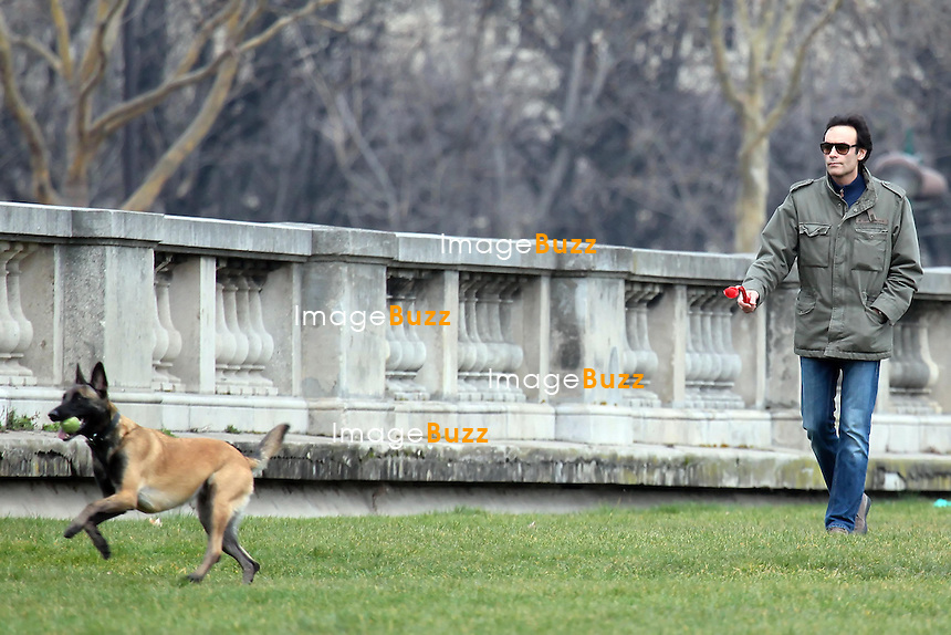 ANTHONY DELON - Anthony Delon, son of Alain Delon, plays with his dog in Paris. March 7, 2013. Exclusive