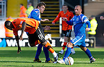 Dundee Utd v St Johnstone...25.09.10  .Prince Buaben battles with Murray Davidson and Jody Morris.Picture by Graeme Hart..Copyright Perthshire Picture Agency.Tel: 01738 623350  Mobile: 07990 594431
