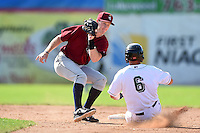 Mahoning Valley Scrappers shortstop Austin Fisher (12) attempts to tag Erik Lunde (6) sliding in during a game against the Jamestown Jammers on June 15, 2014 at Russell Diethrick Park in Jamestown, New York.  Jamestown defeated Mahoning Valley 9-4.  (Mike Janes/Four Seam Images)