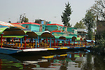 "Xochimilco is one of the sixteen boroughs within Mexican Federal District. Today,the borough consists of eighteen neighborhoods along with fourteen villages that surround it. While the neighbhoods are somewhat in the geographic center of the Federal District, it is considered to be ""south"" and has an identity separate from the historic center of Mexico City. Xochimilco is best known for its canals, which are left from what was an extensive lake and canal system that connected most of the settlements of the Valley of Mexico. These canals, along with artificial islands called chinampas, attract tourists and other city residents to ride on colorful gondolas called<br />