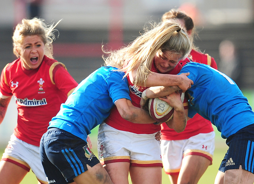 Wales&rsquo; Hannah Jones is tackled by Italy&rsquo;s Paola Zangirolami<br /> <br /> Photographer Kevin Barnes/CameraSport<br /> <br /> International Women's Rugby Union - RBS Women's Six Nations Championships 2016 Round 5 - Wales Women v Italy Women - Sunday 20th March 2016 - Aberavon RFC, Port Talbot<br /> <br /> &copy; CameraSport - 43 Linden Ave. Countesthorpe. Leicester. England. LE8 5PG - Tel: +44 (0) 116 277 4147 - admin@camerasport.com - www.camerasport.com