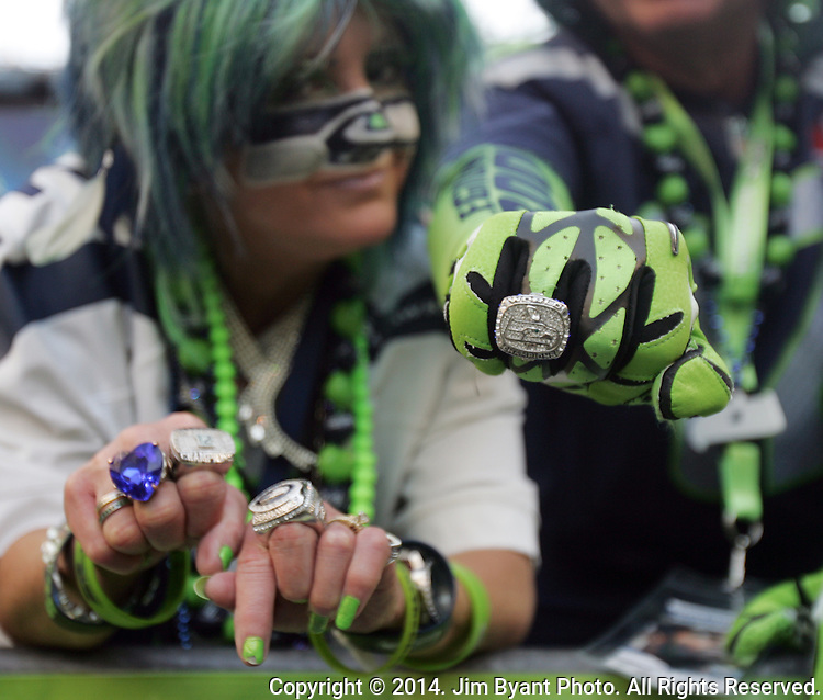 Seattle Seahawks fans show off their replica Conference and Super Bowl Championship rings during the game against the  Denver Broncos at CenturyLink Field in Seattle, Washington on September 21, 2014. The Seahawks won 26-20 in overtime.    ©2014. Jim Bryant Photo. All rights Reserved.