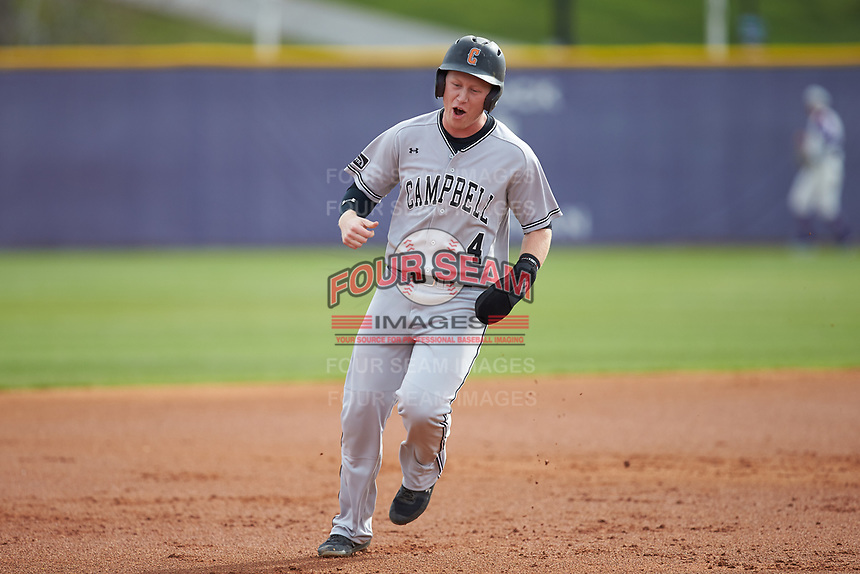 Collin Wolf (4) of the Campbell Camels reacts as he rounds third base following a home run by teammate Zach Minnick (not pictured) during the game against the High Point Panthers at Williard Stadium on March 16, 2019 in  Winston-Salem, North Carolina. The Camels defeated the Panthers 13-8. (Brian Westerholt/Four Seam Images)