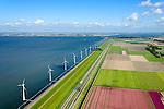 Nederland, Flevoland, Gemeente Lelystad, 07-05-2015. IJsselmeerdijk met windturbines in het water van het IJsselmeer, windmolenpark (windpark) van NUON. Omgeving van de Maximacentrale gezien naar de Noordoostpolder. Links het water van het IJsselmeer, rechts van autosnelweg de A6 bloembollenvelden, voornamelijk tulpenvelden.<br /> Windmills, part of the wind farm (or wind park) of NUON in the water of the IJsselmeer. Right the A6 motorway with flowerbulb fields with tulips, left the water of the IJsselmeer.<br /> luchtfoto (toeslag op standard tarieven); aerial photo (additional fee required); copyright foto/photo Siebe Swart