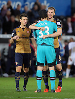 (L-R) Laurent Koscielny of Arsenal celebrates his team's win with team mates Petr Cech and Per Mertesacker during the Barclays Premier League match between Swansea City and Arsenal at the Liberty Stadium, Swansea on October 31st 2015