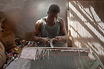 Rising paint prices forced  artist Dickens Otieno, 32, to search for free raw materials to continue his work. Today he recyles tin cans into a canvas of woven metal.