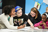 Layla Allen, 10 (from left), Maggy Huber, 10 and Mady Hantuba, 10, watch Laura Cooksey, youth development coordinator, (second from left) draw, Thursday, January 9, 2019 at the Boys and Girls Club in Bentonville.<br /> <br /> Thursday was national law enforcement appreciation day. Kids at the Boys and Girls Club made coloring sheets and wrote thank you notes to show appreciation for law enforcement. They will send some of the best ones to the Bentonville police department. Check out nwaonline.com/200110Daily/ for today's photo gallery.<br /> (NWA Democrat-Gazette/Charlie Kaijo)