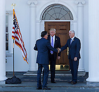 United States President-elect Donald Trump and Vice President-elect Mike Pence greet Mitt Romney at the clubhouse at Trump International Golf Club, November 19, 2016 in Bedminster Township, New Jersey. <br /> Credit: Aude Guerrucci / Pool via CNP /MediaPunch