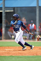 GCL Rays left fielder Tony Pena (24) grounds out during the first game of a doubleheader against the GCL Twins on July 18, 2017 at Charlotte Sports Park in Port Charlotte, Florida.  GCL Twins defeated the GCL Rays 11-5 in a continuation of a game that was suspended on July 17th at CenturyLink Sports Complex in Fort Myers, Florida due to inclement weather.  (Mike Janes/Four Seam Images)