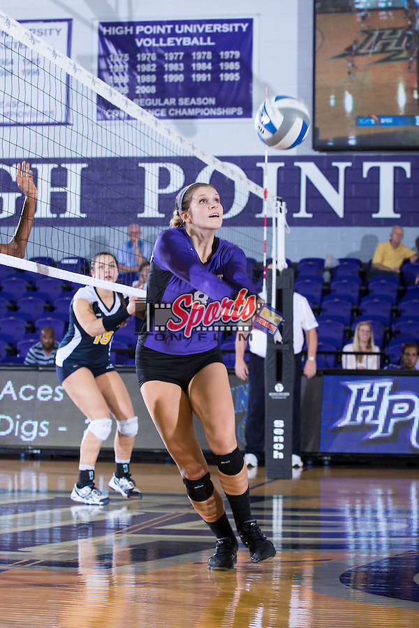 Gabi Mirand (8) of the High Point Panthers digs the ball against the UNC Greensboro Spartans at Millis Athletic Center on September 16, 2014 in High Point, North Carolina.  The Panthers defeated the Spartans 3-0.   (Brian Westerholt/Sports On Film)