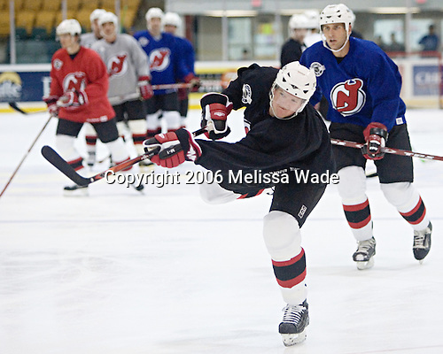 Paul Martin shoots the puck. The New Jersey Devils and prospects took part in their second official on-ice day of training camp on Saturday, September 16, 2006 at the Richard E. Codey Rink at South Mountain in West Orange, New Jersey.<br />