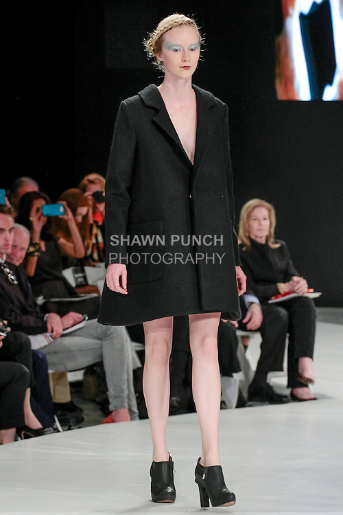 Model walks runway in an outfit by Simone Kurland, during the 2013 Pratt Institute Fashion Show, on April 25, 2013.