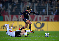 Carli Lloyd (10) dribbles past Anja Mittag... US Women's National Team defeated Germany 1-0 at Impuls Arena in Augsburg, Germany on October 27, 2009.