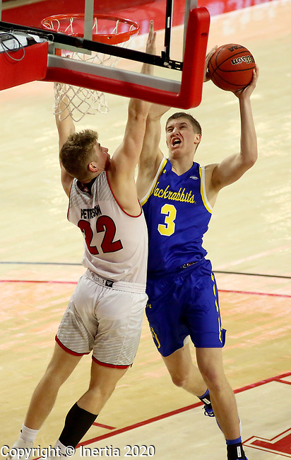 VERMILLION, SD - JANUARY 19: Baylor Scheierman #3 of South Dakota State Jackrabbits takes the ball to the basket against Tyler Peterson #22 of South Dakota Coyotes at the Sanford Coyote Center on January 19, 2020 in Vermillion, South Dakota. (Photo by Dave Eggen/Inertia)