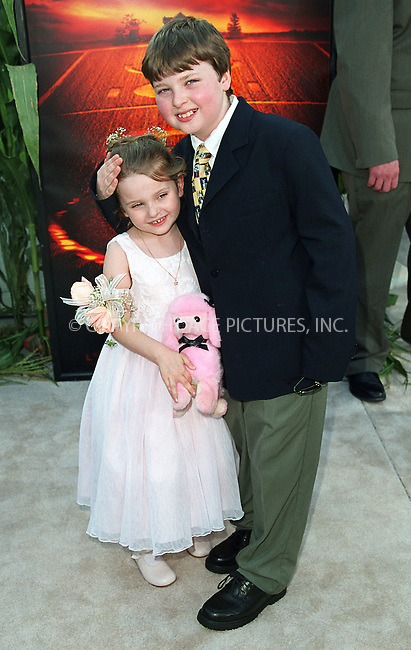 """Abigail Breslin and her brother Spencer Breslin arrive at the world premiere of Touchstone Pictures' movie, """"Signs"""" at Lincoln Center, New York. July 29, 2002. Please byline: Alecsey Boldeskul/NY Photo Press.   ..*PAY-PER-USE*      ....NY Photo Press:  ..phone (646) 267-6913;   ..e-mail: info@nyphotopress.com"""