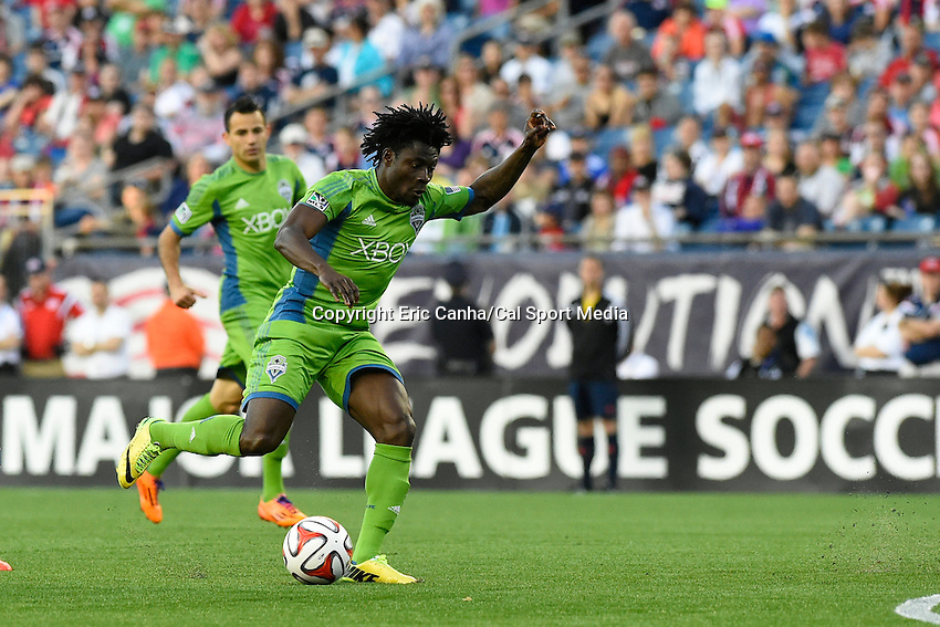 May 11, 2014 - Foxborough, Massachusetts, U.S. - Seattle Sounders FC forward Obafemi Martins (9) lines up a kick during the MLS game between the Seattle Sounders FC and the New England Revolution held at Gillette Stadium in Foxborough Massachusetts.  New England defeated Seattle 5-0   Eric Canha/CSM