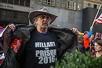 NEW YORK,NY October 29,2016. A man wears a t-shirt calling Hillary for prison during  a rally for Donald Trump outside of Trump Tower in Manhattan, October 29,2016. Photo by VIEWpress/Maite H. Mateo