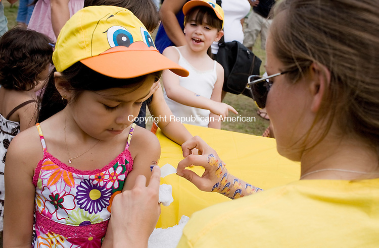 NAUGATUCK--31 May 08--053108TJ16 - Alice Pereira, 6, of Naugatuck, gets a duck day temporary tattoo during Naugatuck's third annual Duck Day Race on Saturday, May 31, 2008. Visit www.rep-am.com to view a photo gallery of this event. (T.J. Kirkpatrick/Republican-American)
