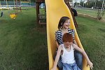 After school, Brittni and Brant enjoy a little playtime at the neighborhood playground, a part of the  FAITH center, one of many places the family has lived.