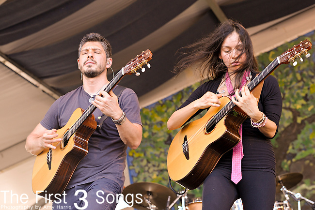 Gabriela Quintero and Rodrigo Sanchez of Rodrigo y Gabriela and C.U.B.A. perform during the New Orleans Jazz & Heritage Festival in New Orleans, LA on May 4, 2012.