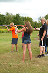Teenagers shooting rifles