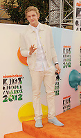 LOS ANGELES, CA - MARCH 31: Cody Simpson arrives at the 2012 Nickelodeon Kids' Choice Awards at Galen Center on March 31, 2012 in Los Angeles, California.