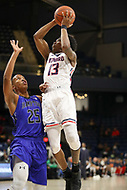 Washington, DC - December 22, 2018: Howard Bison guard Charles Williams (13) attempts a shot over Hampton Pirates guard Akim Mitchell (25) during the DC Hoops Fest between Hampton and Howard at  Entertainment and Sports Arena in Washington, DC.   (Photo by Elliott Brown/Media Images International)