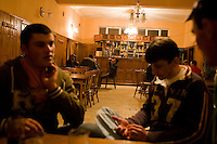 ROMANIA / Maramures / Valeni / 30.04.2008 ..Drinking in the village bar at night. Maramures is home to some of the most traditional rural life left in Europe. ..© Davin Ellicson / Anzenberger