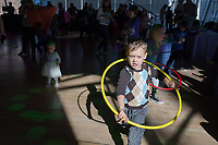 NWA Democrat-Gazette/CHARLIE KAIJO Max Spangler 5, of Bentonville (right) hula-hoops during the Noon Year's Eve event on Sunday, December 31, 2017 at Crystal Bridges in Bentonville. Visitors rang in the New Year (without staying up past bedtime) at the third annual family celebration including arts projects, performances and a family dance party.