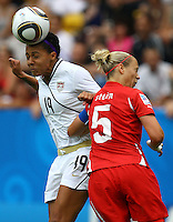 USA's Sydney Leroux (L) and Danique Stein of Switzerland during the FIFA U20 Women's World Cup at the Rudolf Harbig Stadium in Dresden, Germany on July 17th, 2010.