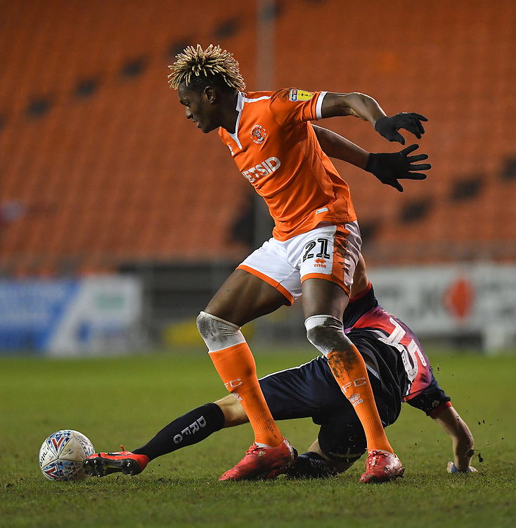 Blackpool's Armand Gnanduillet battles with Doncaster Rovers' Herbie Kane<br /> <br /> Photographer Dave Howarth/CameraSport<br /> <br /> The EFL Sky Bet League One - Blackpool v Doncaster Rovers - Tuesday 12th March 2019 - Bloomfield Road - Blackpool<br /> <br /> World Copyright © 2019 CameraSport. All rights reserved. 43 Linden Ave. Countesthorpe. Leicester. England. LE8 5PG - Tel: +44 (0) 116 277 4147 - admin@camerasport.com - www.camerasport.com