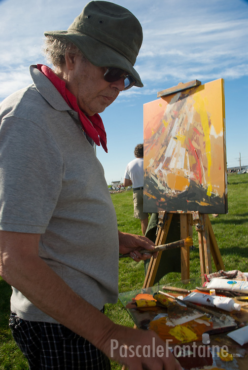 Contemporary realist artist René Lemay painting at an art contest in Magdalen Islands in August 2010. The painting was sold 2000$ at the auctions few hours later.