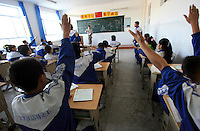 Uyghur students study in Hetian Experimental Billingual School, in Hetian, Xinjiang province, China, on October 13, 2006. The Uyghur people are a Turkic ethnic group living mainly in the Xinjiang Uyghur Autonomous Region of China. Photo by Lucas Schifres/Pictobank