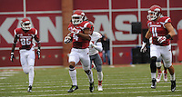 NWA Media/ANDY SHUPE - Arkansas receiver Keon Hatcher (4) carries the ball through the Nicholls defense on his way to the end zone on the first play of the game during the first quarter Saturday, Sept. 6, 2014, at Razorback Stadium in Fayetteville