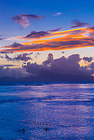 Sunset over the island of Moorea, seen from Manava Suite Beach Resort, Punaauia, Tahiti, French Polynesia.