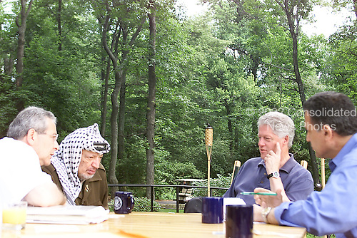 United States President Bill Clinton meets with Palestinian Authority Chairman Yasser Arafat on Tuesday morning, July 25, 2000 at Camp David in Thurmont, Maryland.  From left to right: Gemal Helal, interpreter; Chairman Arafat, President Clinton; Nabil Aburudineh..Mandatory Credit: White House via CNP