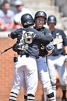Vanderbilt Commodores right fielder Jeren Kendall (3) is greeted by teammates after hitting a home run during a game against the Tennessee Volunteers at Lindsey Nelson Stadium on April 24, 2016 in Knoxville, Tennessee. The Volunteers defeated the Commodores 5-3. (Tony Farlow/Four Seam Images)