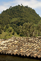 Red tiled roof and hill in the Lenca Indian village of La Campa, Lempira, Honduras...