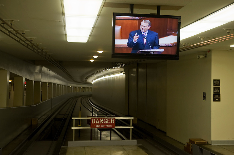 UNITED STATES - JULY 29:  Speaker John Boehner, R-Ohio, is seen on a closed circuit television in the subway leading to Rayburn Building before the House voted on his plan to raise the debt ceiling called the Budget Control Act.  (Photo By Tom Williams/Roll Call)